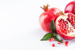 Juicy pomegranate and its half with leaves Stock Images
