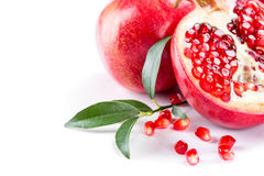 Juicy pomegranate and its half with leaves Stock Photography