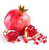 Juicy pomegranate and its half Royalty Free Stock Photos