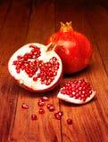 Juicy pomegranate open Stock Image