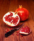 Juicy pomegranate open Stock Images