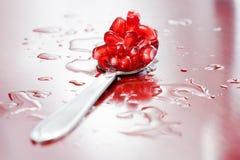 Juicy pomegranate seeds. Royalty Free Stock Photos