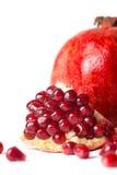 Juicy pomegranate on white background. Royalty Free Stock Images