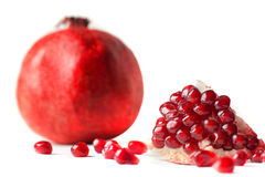Juicy pomegranate on white background. Juicy pomegranate isolated on white background Royalty Free Stock Images