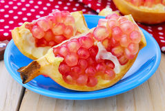 Juicy pomegranate , whole , ripe and cut open Royalty Free Stock Images