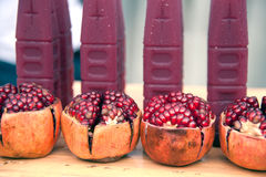 Juicy pomegranate on wooden boards. Stock Photo