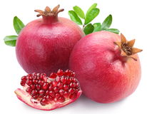 Juicy pomegranates and its section. Stock Images