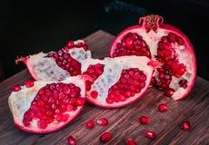 Juicy pomegranates . Stock Photo