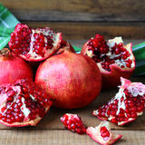 Juicy pomegranates on the table Royalty Free Stock Photo