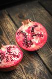 Juicy pomegranates on wood Royalty Free Stock Images