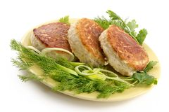 Juicy pork chops with a garnish from greens royalty free stock image