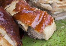 Juicy pork on the green leaf. Traditional cooked pig meat on market