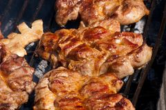 Juicy pork meat on grill. Juicy pork grill in summer time Royalty Free Stock Photography
