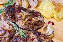 Juicy pork steaks Stock Photo