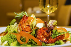 Juicy portions of grilled tiger prawns  with greens and vegetabl Stock Photography
