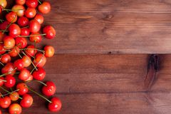 Juicy rainer cherry. On wooden table Royalty Free Stock Photography
