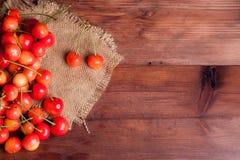 Juicy rainier cherries on linen napkin. On wooden table Royalty Free Stock Image