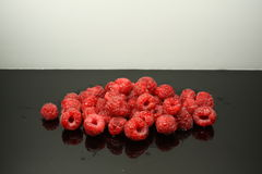 Fresh raspberies with a white background Stock Images