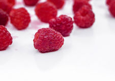 Juicy raspberry raspberries scattered on white. Ripe raspberries on white background. Useful berries for jam Royalty Free Stock Photo