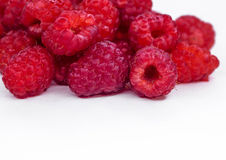 Juicy raspberry raspberries scattered on white. Ripe raspberries on white background. Useful berries for jam Stock Photos