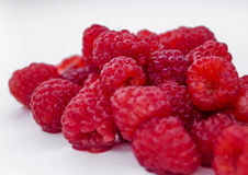 Juicy raspberry raspberries scattered on white. Ripe raspberries on white background. Useful berries for jam Stock Images