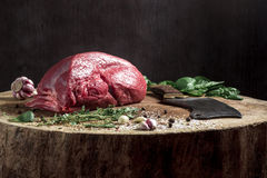 Juicy raw beef steak on wooden table Stock Image