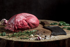 Juicy raw beef steak on wooden table Stock Photography