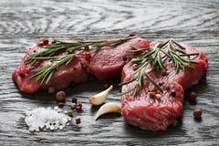 Juicy raw beef steaks Stock Images