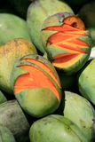 Juicy and ready-to-eat mangoes. Mountains of fresh mangoes on a market, Ujung Pandang, South Sulawesi, Indonesia stock image
