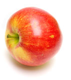 Juicy red apple. The ripe juicy red apple . Isolation on white, shallow DOF Royalty Free Stock Images
