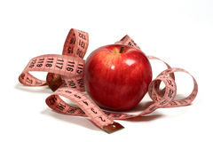 Juicy, red apple and centimeter. Stock Photo