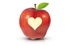 Juicy red apple for health. High resolution photo of a red apple with condensation nd a heart cut out representing health and well-being Royalty Free Stock Images