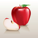 Juicy red apple and a piece Royalty Free Stock Photos