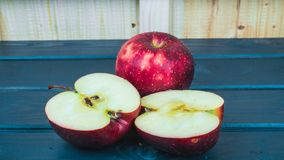 Apples. Juicy Red apples on the blue table Stock Photo