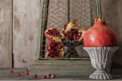 Juicy red garnet gray vintage vase. On a gray stone background royalty free stock photo