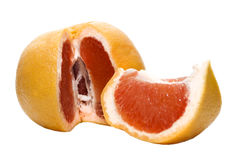 Juicy red grapefruit. Juicy ripe red grapefruit with a slice Royalty Free Stock Photo