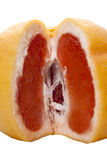 Juicy red grapefruit. Juicy ripe red grapefruit with a slice Stock Photo