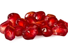 Juicy red pomegranate of grain close up isolated Stock Images