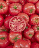 Juicy red tomato cut Royalty Free Stock Photography