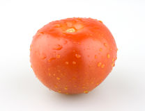 Juicy red tomato with water droplets. Juicy red tomato with some water droplets Royalty Free Stock Image