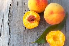 Juicy rich summer peachs on the wood plank Royalty Free Stock Photo