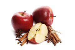 Juicy ripe apples with cinnamon and star anise isolated on white background royalty free stock images