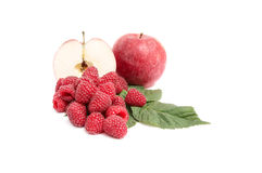 Juicy,ripe apples and raspberries on a white. Stock Image