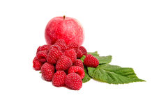 Juicy,ripe apples and raspberries on a white. Stock Images