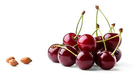 Juicy ripe cherries and cherrystones. Isolated on white background stock photo