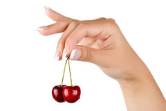 Juicy ripe cherry in the beautiful female hand Royalty Free Stock Images