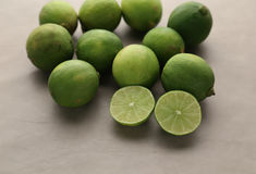 Juicy ripe citrus on an old wooden table - lime. Fresh ripe limes on wooden table. Top view Royalty Free Stock Images