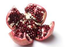Juicy ripe fresh pomegranate fruit cut opened. Isolated stock photo