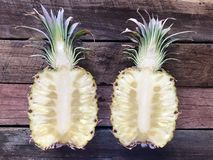 Pineapple Halves Open on Wooden Background. Juicy ripe fresh tropical healthy pineapple halves on Pink Background. Fruity and delicious royalty free stock photography