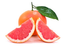 Juicy ripe grapefruit with green leaves. Stock Photography